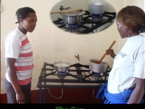 women cooking using biogas at a Biocentre