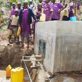 Pupils collecting water in Uganda. In every society, water , health and education are closely inter-related