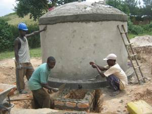 Men constructing a water tank in Uganda for rainwater harvesting