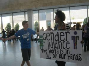 An African youth holds a placard at the COP 18 in Doha