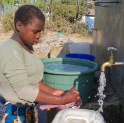 A water Kiosk in Ndirande Malawi. In places without access to clean water children and walk long distances, use dirty water from ponds and rivers or they are charged large amounts of money by water sellers.