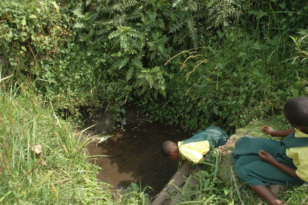 Bushozi primary school pupils in Buhweju district struggle to fetch water