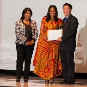 PhD Fellow Aline Saraiva Okello in the middle receiving her ward