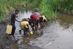 Children in Bunusya in Kakiika Sub County, Mbarara district of southwestern Uganda fetch water from a swamp