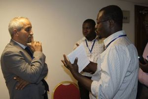 Journalists Kaah Aaron and Kofi Adu Domfeh interviewing Dr. Abdellatif working with IPCC adaptation group. This was during the CCDA-IV in Morocco