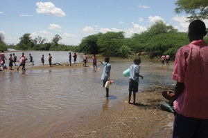 Children of Katilu Primary school in Kenya fetching water at River Turkwel
