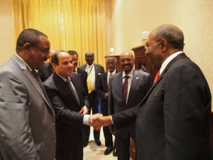 Uganda's Prime Minister Dr Rugunda (right) shakes hands with Egyptian President Abdel Fattah al-Sisi, while Ethiopian PM Hailemariam Desalegn (left) and Sudanese President Omar al-Bashir (second right) look on in Khartoum