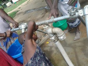 A child drinking water from the tap in  Bangula camp in Nsanje district of Malawi