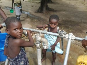 Children fetching water in Bangula camp in Nsanje district of Malawi