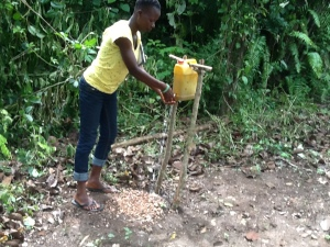 Belinda Kotoka of Konsuaso, Kejabi District of Volta region in Ghana washing her hands