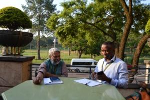 Dr. Rajendra Singh (L) chats with Fredrick Mugira (R) in Pretoria, South Africa