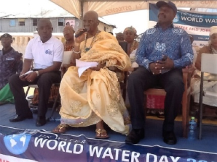 Nii Oblempong Ababio addressing the gathering. Seated on his left hand side is Ghana's Minister of Water Resources, Works and Housing Dr. Kwaku Agyemang Mensah