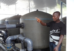 Manager of the Eleme Integrated Water Treatment Plant Explaining a point to visitors