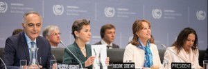Officials, including the Executive Secretary of the UN Framework Convention on Climate Change Christiana Figueres (second from left) at the opening plenary of the meeting.