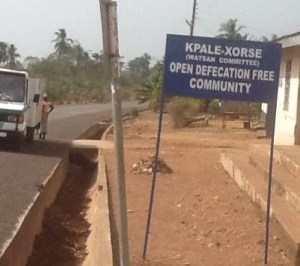 A sign post displaying the ODF status of the community