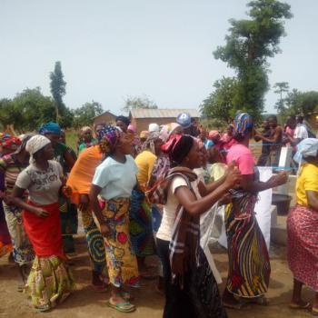 Women of Unguwa Kanti community dancing round the bore hole in appreciation