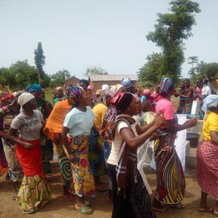 Women of Unguwa Kanti community dancing round the bore hole in appreciation