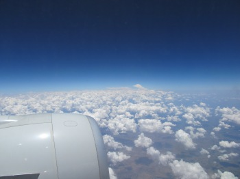 Scientists believe that a warmer Earth is pushing clouds upward and poleward