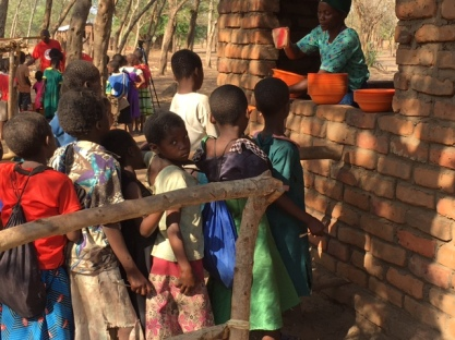 Learners queue for porridge at Mavuwa in Chikwawa, Malawi.